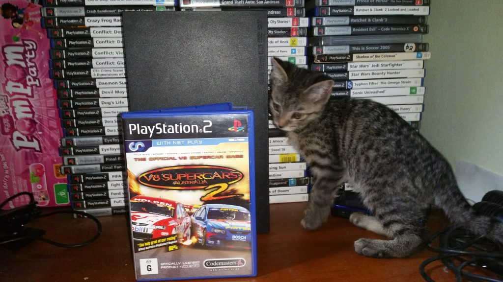 Bhaalgorn (Kitten) inspects a copy of the game.